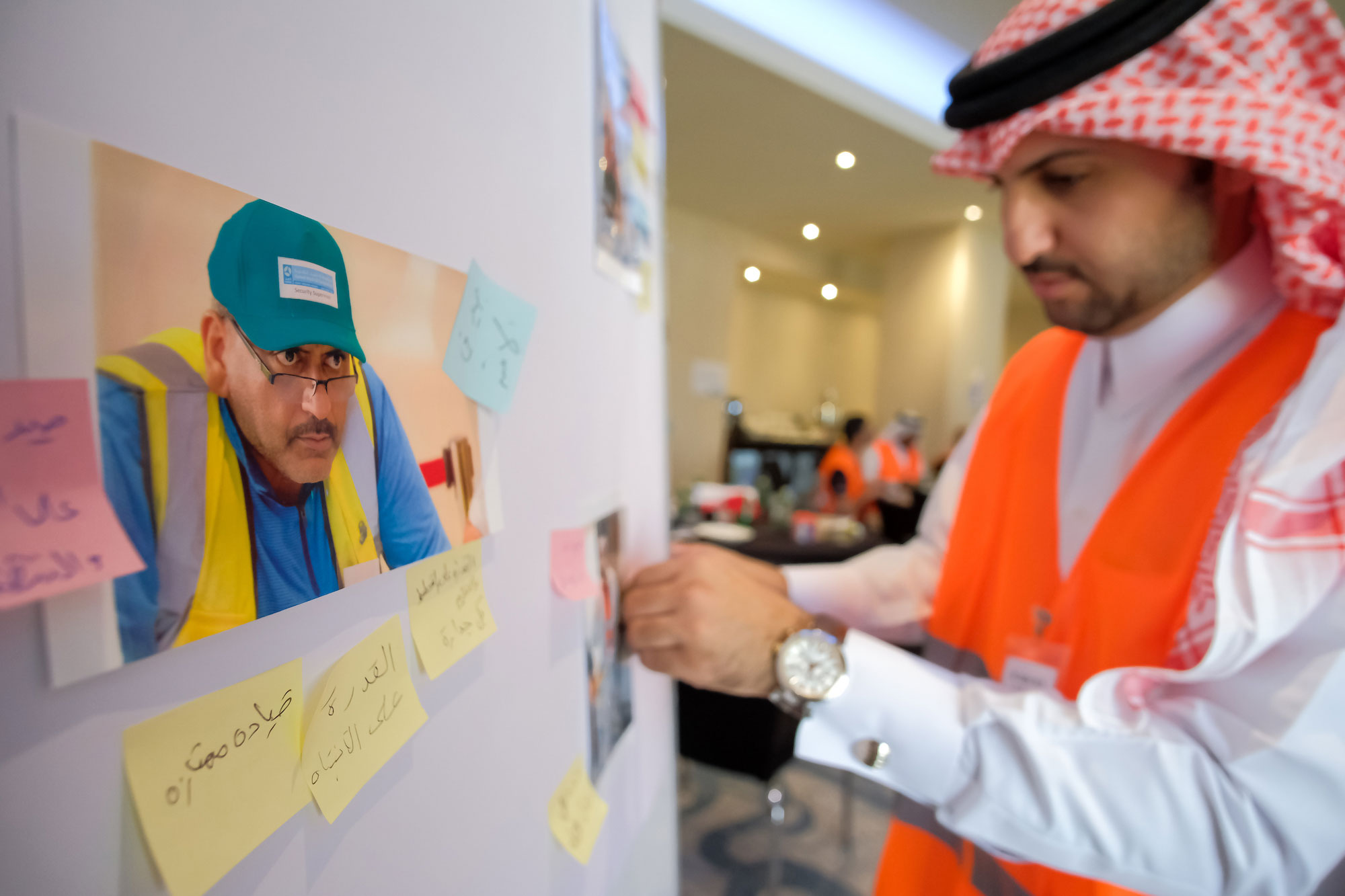 Qatari man brainstorming ideas in a leadership workshop