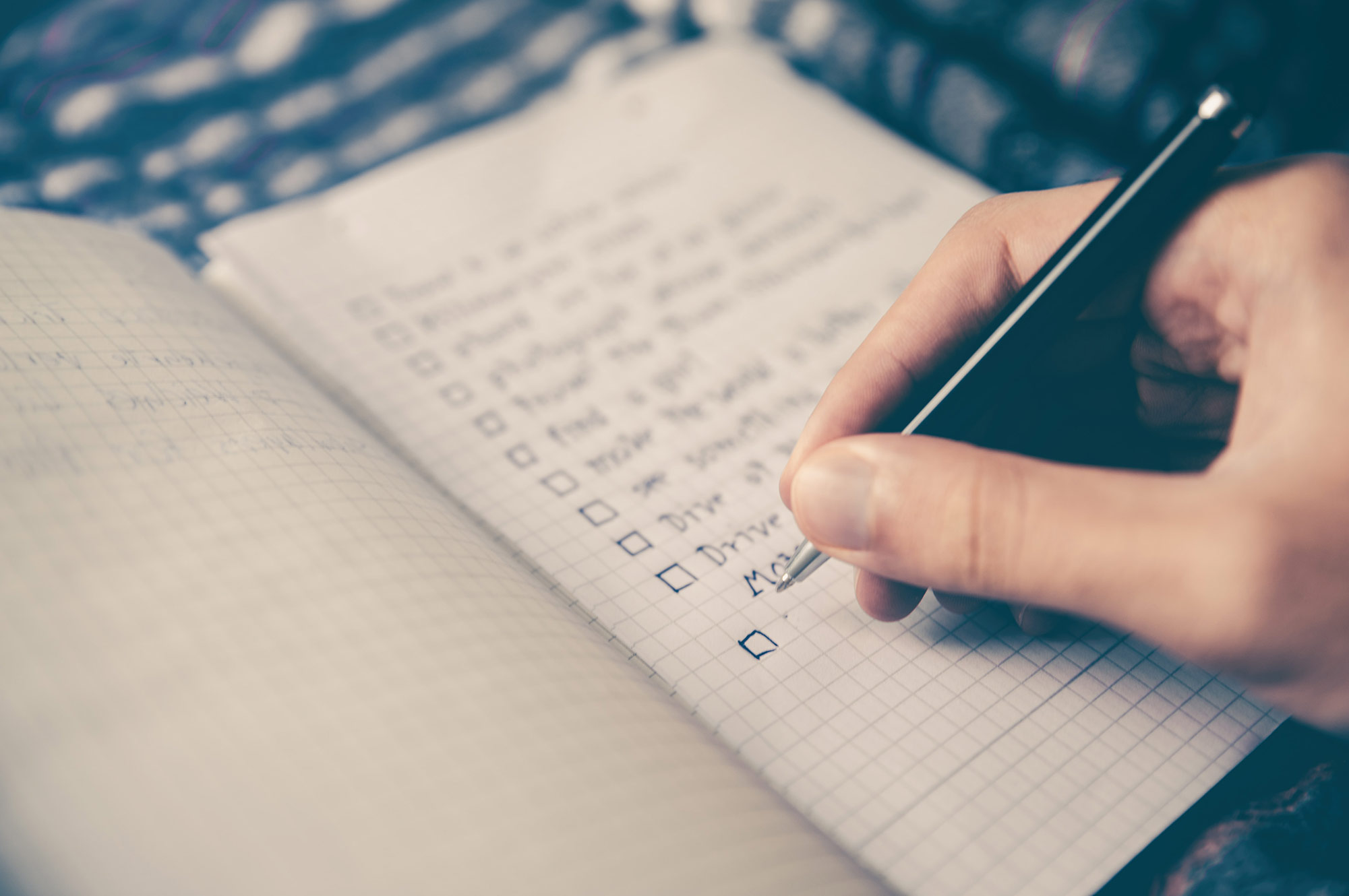 making a list of skills in a notebook