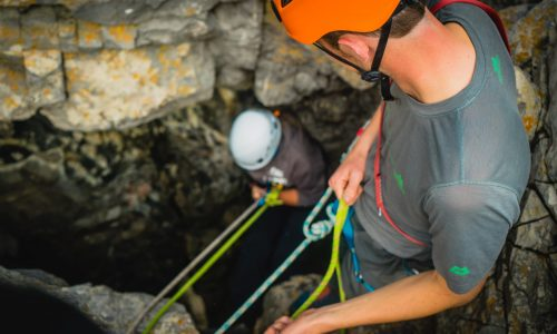 Abseiling in to a cave